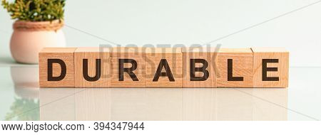 Durable Motivation Text On Wooden Blocks Business Concept White Background. Front View Concepts, Flo