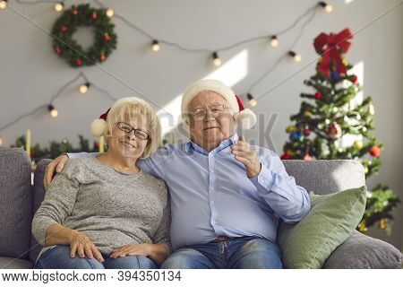Happy Elderly Couple Congratulating Family With New Year Holidays Online During Videocall At Home