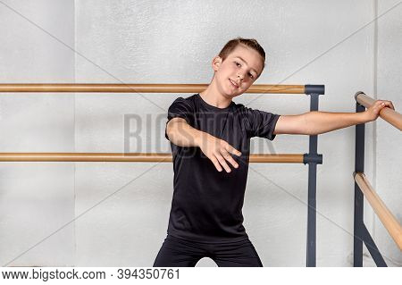 Boy To Study Ballet At The Ballet School. The Hand On The Ballet Barre.