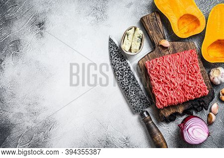 Raw Mince Meat, Pumpkin With Garlic And Onion. White Background. Top View. Copy Space