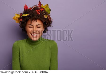 Joyous Overjoyed African American Woman Has Specific Appearance, Smiles Gently, Wears New Clothes, F
