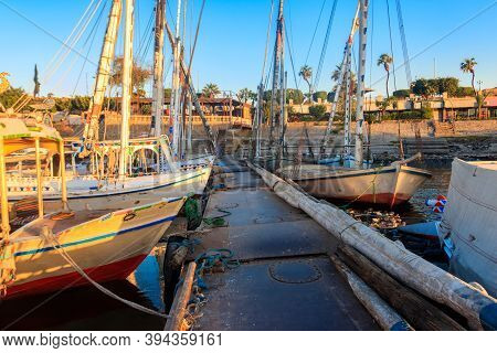 Felucca Boats Moored At The Pier In Luxor, Egypt