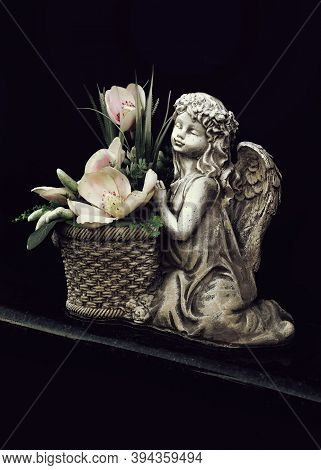 Guardian Angel Grave Ornament. Angel And Flowers On Grave
