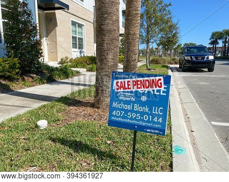 Orlando, Fl/usa-2/29/20: A Realtor Sign In Front Of A Condo That Says Sale Pending In Laureate Park
