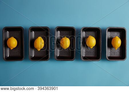 Picked Ripe Fresh Lemons On Trays Ready To Be Added To Some Dishes For Sour Flavor, Making Refreshin