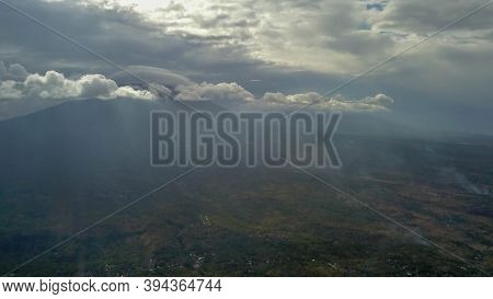Volcano With Cloudy Clear Sky. Mount Merapi In Indonesia. Cloudy Sky With A Volcano In The Backgroun