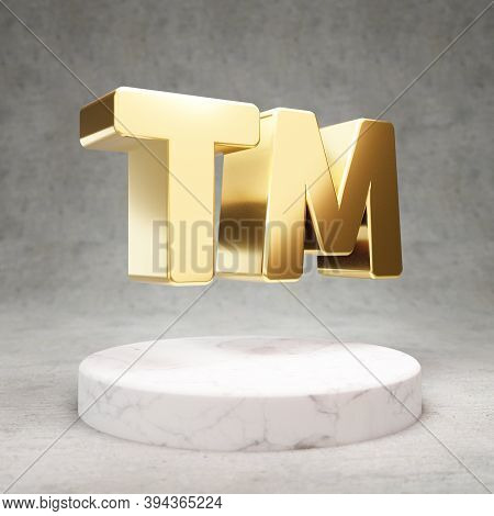 Trademark Icon. Gold Glossy Trademark Symbol On White Marble Podium. Modern Icon For Website, Social