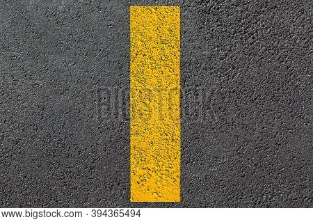 Yellow Dashed Line Of Road Markings Close-up On The New Bituminous Asphalt Road Surface Top View Of