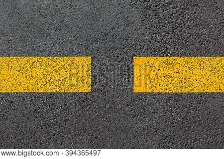 Two Yellow Dashed Line Of Road Markings Close-up On The New Bituminous Asphalt Road Surface Top View