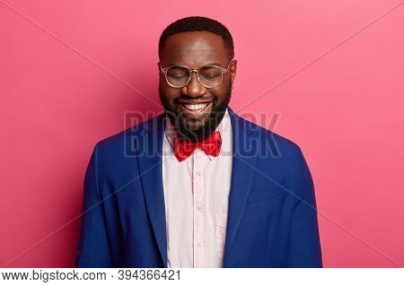 Lucky Bearded Male Entrepreneur Laughs Gladfully, Feels Ecstatic And Happy To Hear About Successful
