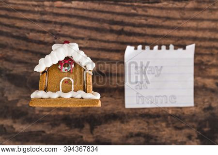 Holidays In Lockdown Due To Covid, Mini Decorative Christmas Gingerbread House With Memo About Stayi