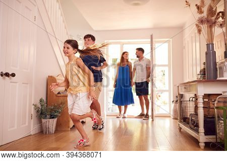 Family Looking Around New Home Before They Move In