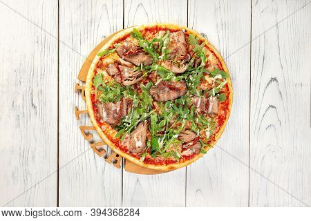 Pizza With Roast Beef On Wooden Background, Top View With Copy Space.