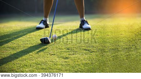 Happy And Cheerful Of The Woman Golf Player In Winning Putt A Ball Completed Into The Hole On The Gr