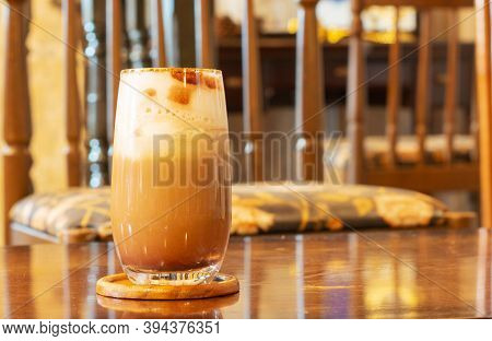 A Glass Of Cold Cappucino On Wooden Table In Vintage Coffee Shop