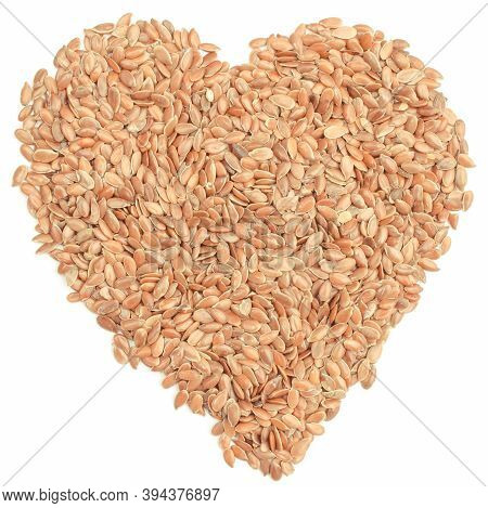 Linseed In Shape Of Heart On White Background. Concept Of Healthy Food Containing Dietary Fiber