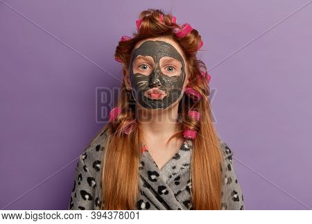 Charming Redhead Girl Lady Keeps Lips Folded, Applies Clay Mask For Healthy Skin, Cares About Comple