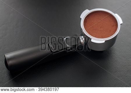 Metal Holder From The Coffee Machine With Ground Coffee Inside. Coffee Horn And Coffee Filter Holder