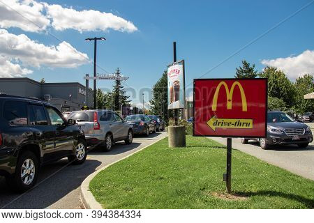 Vancouver,canada - July 13,2020: Cars Lining Up To Order Food Using Drive-thru Facilities At Local M