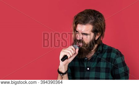 Man Singer Love Music. Brutal Man Sing With Microphone. Vocal School. Brutal And Rock. Bearded Man W
