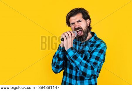Dont Be Shy. Concept Of Music. Singing Man Wearing Checkered Shirt. Confident Male Singer In Karaoke