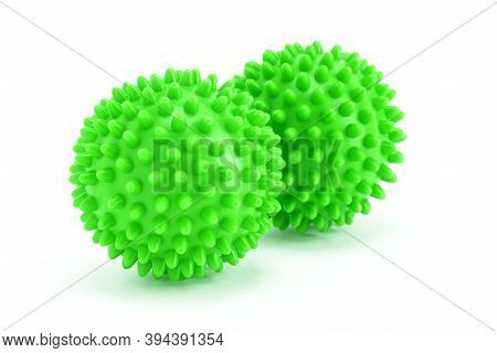 Housework, Washing - Two Green Laundry Balls On A White Background.