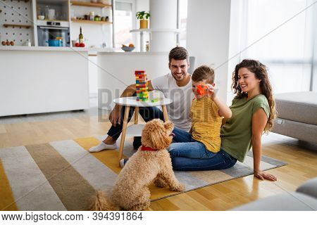 Happy Family With Parents And Son Playing And Having Fun At Home