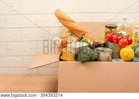 Donation Box With Different Groceries, Food Donations On Light Background With Copyspace - Pasta, Fr