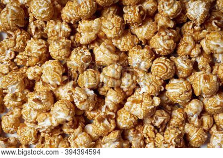 Popcorn With Caramel Close-up. Sweet Popcorn For Movies