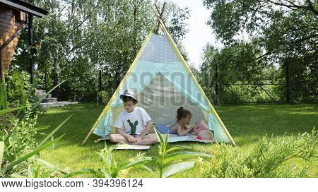 The Child Learns To Read. The Boy Reads The First Children's Book On Syllables. Children Spend Summe