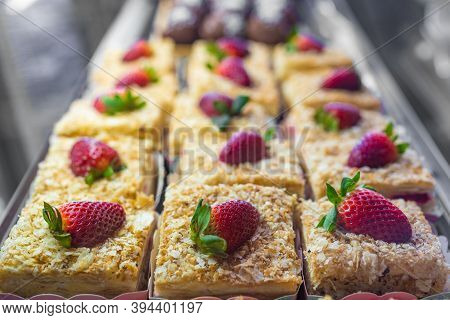 Sponge Cake With Strawberries, A Slice Of Cake On Disposable Tableware, A Biscuit On A Background Of