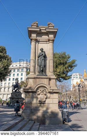 Barcelona, Spain - Feb 24, 2020: Statue On Catalunya Plaza In City Center Sunny Day
