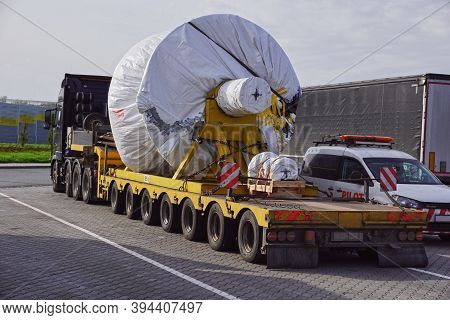 A Trucks With A Special Semi-trailers For Transporting Oversized Loads. Oversize Load Or Exceptional