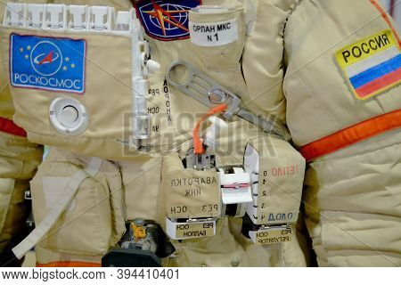 The Spacesuit Of A Russian Cosmonaut From The Iss Space Station. Roscosmos And Russia Inscription On