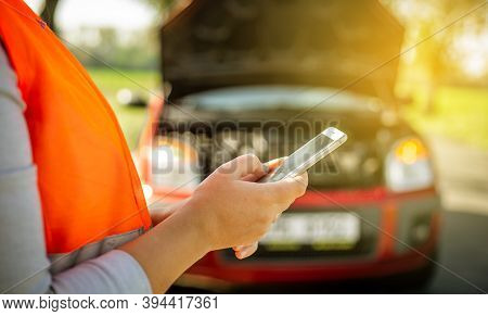 Young Woman Calling The Car Assistance During Car Crash Or Problem, Calling The Insurance Company