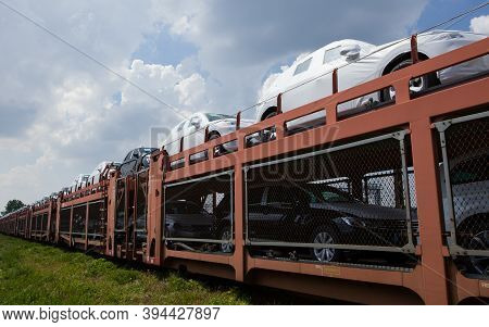Poznan, Poland - May 17, 2019: Transportation Of Cars By Train. Autorack With Cars. New Cars Transpo