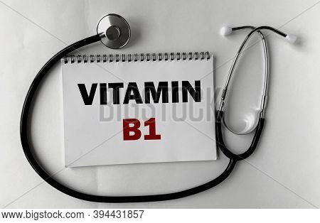 Vitamin B1 On A White Notepad .next To It Is A Stethoscope On A White Background.