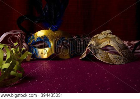 Carnival Masks, Venetian Masks On Shiny Surface With Streamers, Selective Focus.