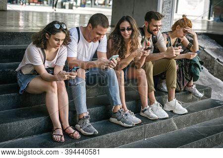 Group Of Friends Using Smartphones. Emotional Isolation And Technology Depresion