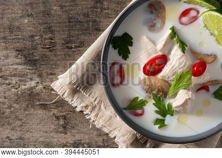 Traditional Thai Food Tom Kha Gai In Bowl On Wooden Table