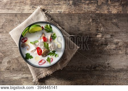 Traditional Thai Food Tom Kha Gai In Bowl On Wooden Table.top View. Copy Space