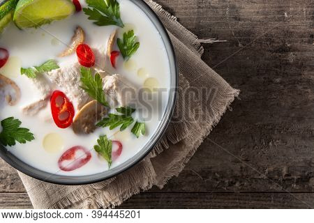 Traditional Thai Food Tom Kha Gai In Bowl On Wooden Table. Top View. Copy Space