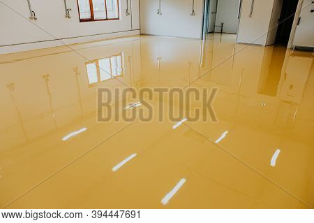 New Epoxy Floor In Warehouse Factory. Construction Series