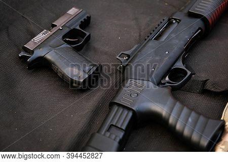 Part Of A Pump-action Shotgun, Pistol And Shells