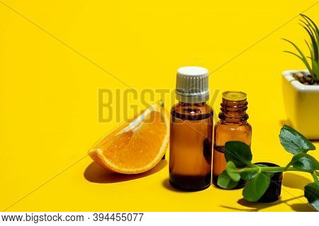 Essential Oils , Various Bottles Aromatherapy On A Yellow Background. Aromatherapy And Perfumes Conc