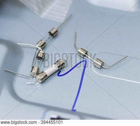 Electronic Components In Grey Background. Four Components. Blur Background.