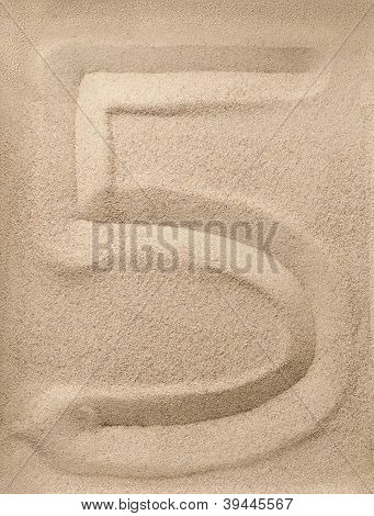 Number five from sand