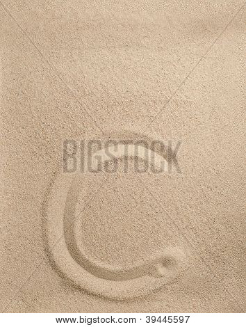 Letter c from sand
