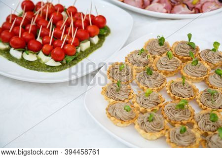 Nicely Decorated Banquet Table With A Variety Of Snacks And Sandwich Appetizers