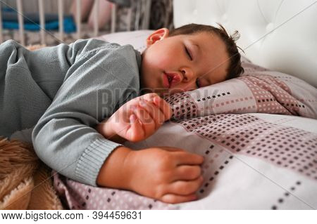 Cute Sleeping Baby Boy. A Child In A Dream. Phases Of Sleep. Deep Dream. Daily Regime. Child Develop